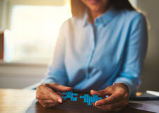Business woman connecting puzzles Stock Photography