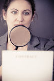 Business woman with contract and loupe Stock Image