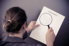 Business woman with contract and loupe Royalty Free Stock Photos
