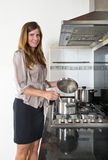Business woman cooking Royalty Free Stock Photos