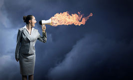 Business woman cooks shouting into a megaphone Stock Photography