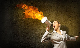 Business woman cooks shouting into a megaphone Royalty Free Stock Image