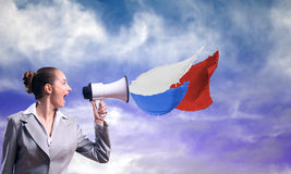 Business woman cooks shouting into a megaphone Stock Image