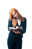 Business woman coquettishly writes in diary Stock Photos
