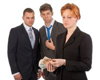 Business woman is counting money with curious male Royalty Free Stock Photo