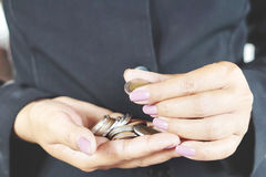 Business woman counting money in hands royalty free stock image