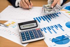 Business woman counts money. work on business charts. royalty free stock photos