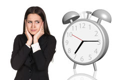 Business woman cover her ears. Alarm clock Royalty Free Stock Photos