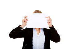 Business woman covering face with blank paper card royalty free stock images