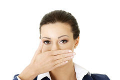 Business woman covering with hand her mouth, Stock Photos