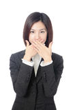 Business woman covering with hands her mouth Royalty Free Stock Image