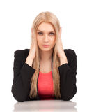 Business woman covering her ears Stock Photo