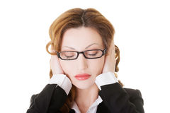 Business woman covering her ears. Royalty Free Stock Image
