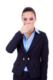 Business woman covering her mouth Royalty Free Stock Photos