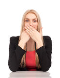 Business woman covering her mouth Royalty Free Stock Photo