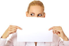 Business woman covering mouth and nose with blank paper sheet Royalty Free Stock Photos
