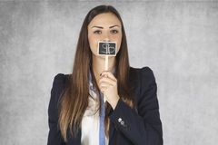 Business woman covers mouth with dollar signs Royalty Free Stock Image
