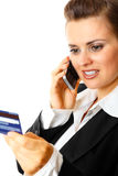 Business woman with credit card and mobile phone Royalty Free Stock Photo