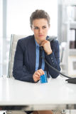 Business woman with credit card and phone Royalty Free Stock Image