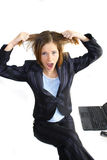Business woman in crisis. Young business woman in crisis screaming nervous pulling her hair Royalty Free Stock Image