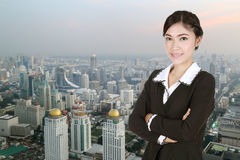 Business woman , crossed arms, with city Royalty Free Stock Photo