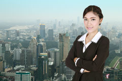 Business woman , crossed arms, with city Stock Images