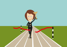 Business woman crossed finish line with trophy Royalty Free Stock Image