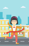 Business woman crossing finish line. Stock Photography