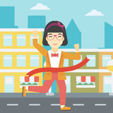 Business woman crossing finish line. Royalty Free Stock Images