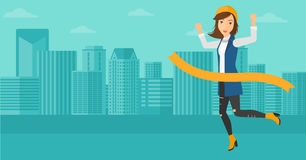 Business woman crossing finish line. A woman running through finishing line on the background of modern city vector flat design illustration. Horizontal layout Royalty Free Stock Photography
