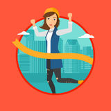 Business woman crossing finish line. Stock Image