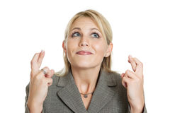Business woman crossing her fingers Royalty Free Stock Photo