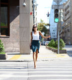 Business woman crossing the road outside Royalty Free Stock Photo