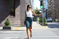 Business woman crossing the road outside Royalty Free Stock Images