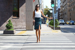 Business woman crossing the road outside Stock Photo