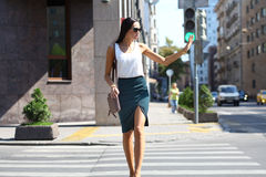 Business woman crossing the road outside Stock Photography