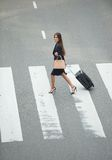 Business woman crossing at zebra crossway Royalty Free Stock Photos