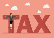 Business woman crucified on tax word. Business concept Stock Images