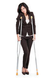 Business woman with crutches Stock Images