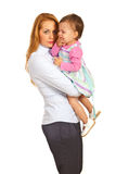 Business woman with crying toddler girl. Business women mother holding crying toddler girl isolated on white background stock image