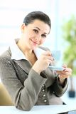 Business woman with cup of coffee Royalty Free Stock Photography