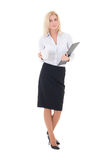 Business woman with cup of coffee and clipboard standing isolate Royalty Free Stock Images