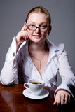 Business woman with a cup of coffee Stock Images