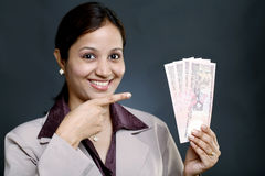 Business woman with currency Royalty Free Stock Photography