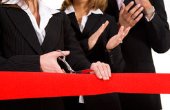 Business: Woman Cuts Red Grand Opening Ribbon While Team Applaud Stock Images