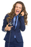 Business woman cutting phone handset Stock Image