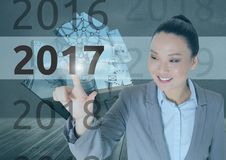 Business woman in 3D digitally generated background touching 2017 Stock Photos