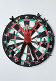 Business woman on dartboard Stock Photos