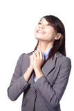 Business woman day dreaming looking up. Smiling happy. Asian beauty model stock image