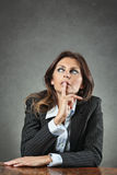 Business woman deeply thinking Royalty Free Stock Photos